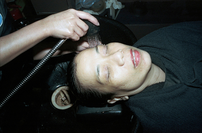 © Paolo Morales, My mother having her hair washed, 2011