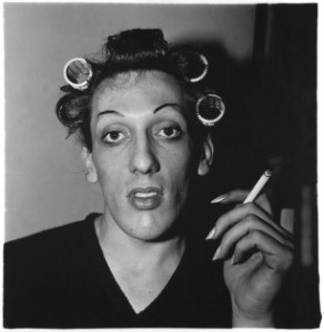 A young man in curlers at home on West 20th Street, N.Y.C., 1966. © The Estate of Diane Arbus
